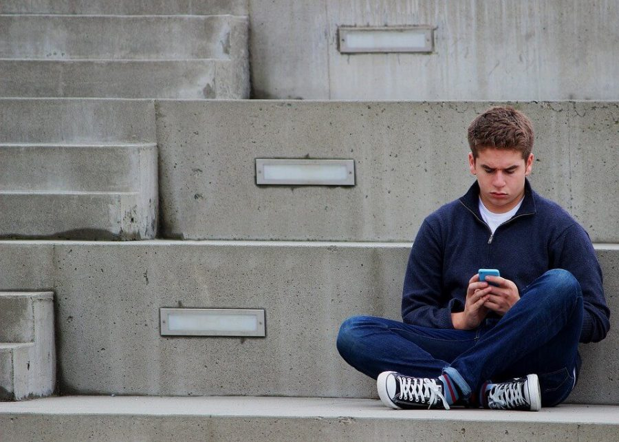 Boy Texting-Outdoor