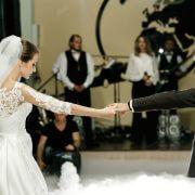 Bride whirls to groom dancing