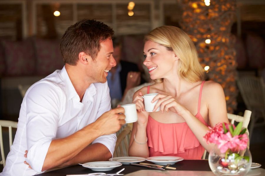 Couple Enjoying Cup Of Coffee In Restaurant