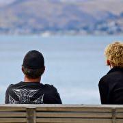 Couple sitting apart