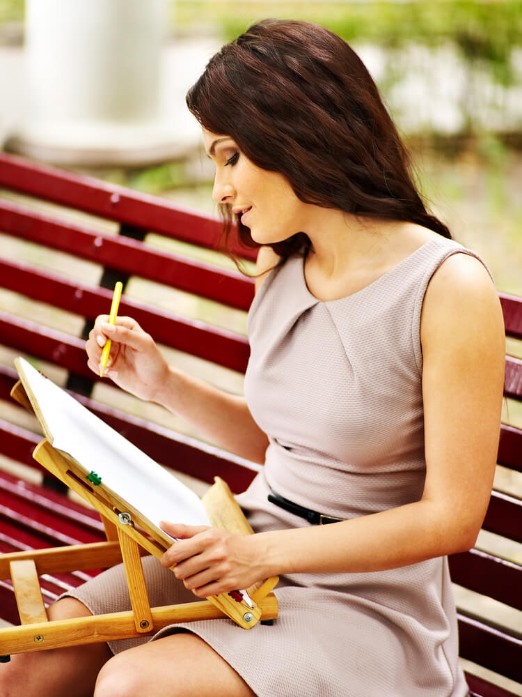 Girl portray on bench at park