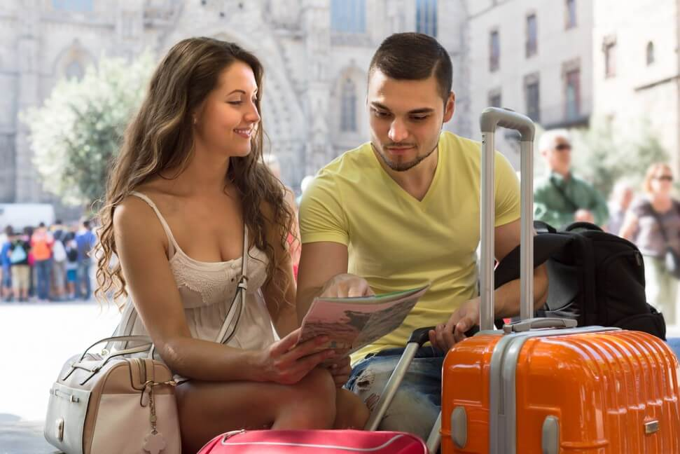 Man with girlfriend reading the map