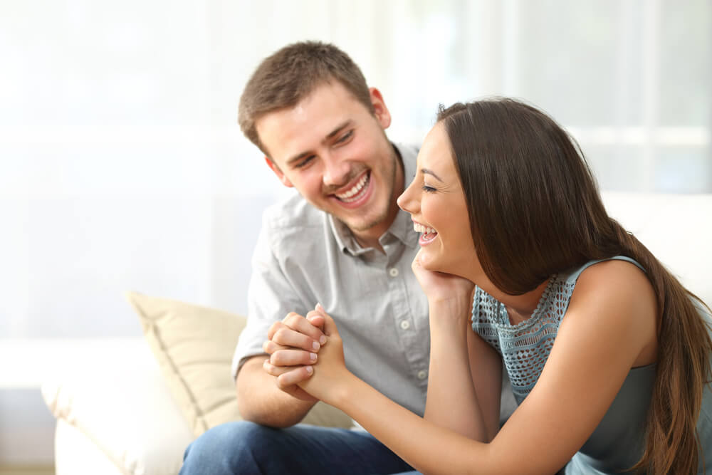 couple laughing and holding hands