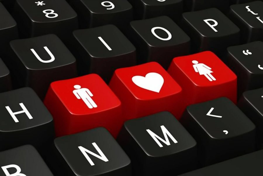 keyboard with a heartshape between man and woman