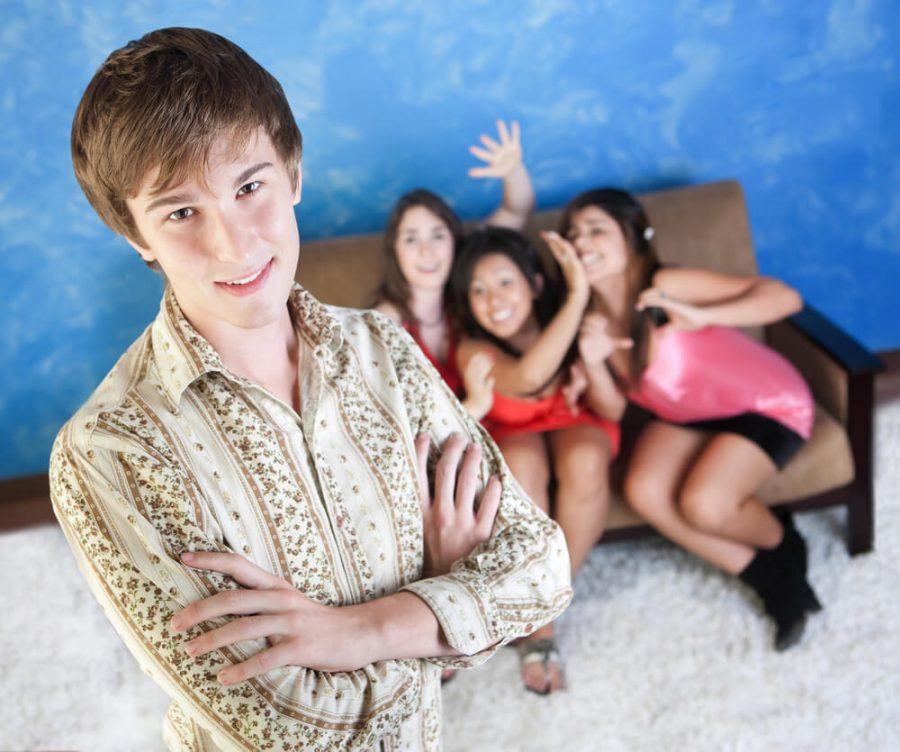 man with three adoring girls