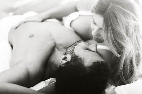 romantic-woman-touching-her-athletic-boyfriend
