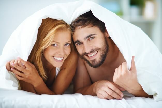 Couple under the bedsheets